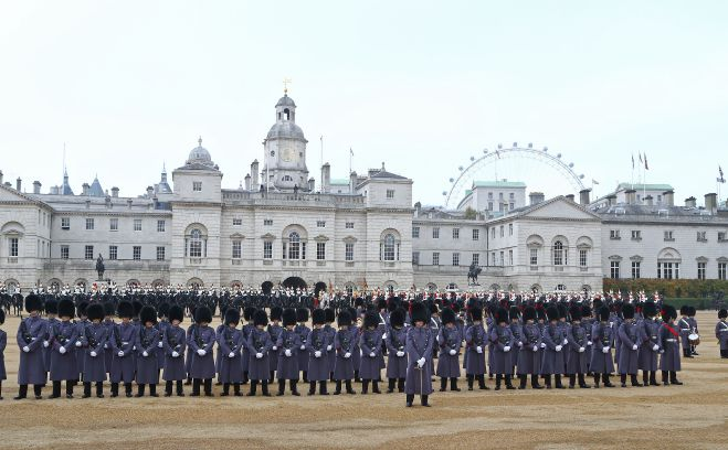 Coldstream Guards line up in preparation for the ceremonial welcome for Colombia's president Juan Manuel Santos, and his wife, Maria Clemencia Rodriguez de Santos, on London's Horse Guards Parade at the start of his official state visit to the UK.