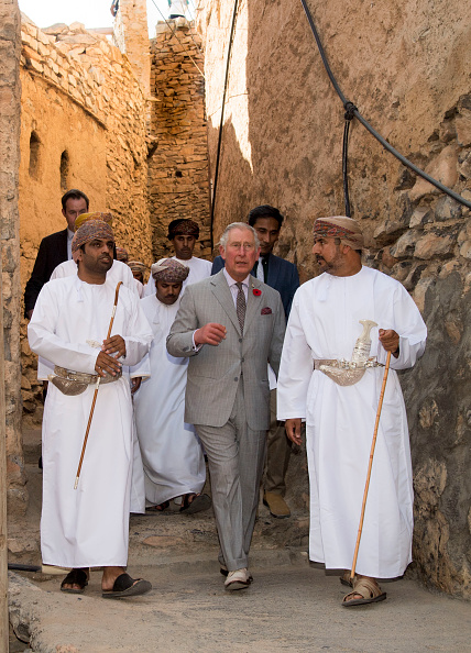 MUSCAT, OMAN - NOVEMBER 05: Prince Charles, Prince of Wales accompanied by a local guide and a representative from the Ministry of Tourism takes a walking tour of the  200 year-old village of Misfat Al Abriyeen village on November 5, 2016 in Muscat, Oman. The Prince stopped at a viewpoint overlooking the city before walking through the narrow pathways of the village and down a hill past an intricate falaj system (the traditional irrigation method) to a restored building which has been turned into a hostel for visitors. Prince Charles, Prince of Wales and Camilla, Duchess of Cornwall are on a Royal tour of the Middle East starting with Oman, then the UAE and finally Bahrain. (Photo by Arthur Edwards - Pool/Getty Images)    Misfat al Abriyeen is a unique mountainous village divided into two distinct settlements  the Old and New villages. The Old village, that His Royal Highness will be touring, was built over 200 years ago and is a traditional Omani village, complete with agricultural terraces along the mountain slopes and traditional mud houses built with carved wooden doors, palm frond roofs and solid rock foundations Picture: Arthur Edwards