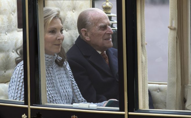 The Duke of Edinburgh with Colombia's president Juan Manuel Santos's wife, Maria Clemencia Rodriguez de Santos arrive by carriage at Buckingham Palace in London at the start of their official state visit to the UK.